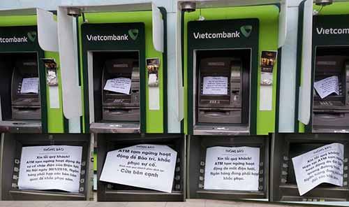 """Hàng loạt máy ATM """"lăn ra ốm"""" dịp cận Tết - hình ảnh 1"""