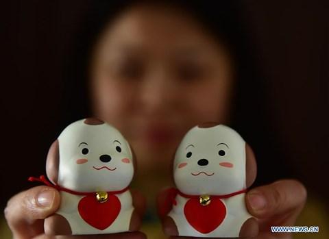 Rực rỡ sắc đỏ Tết Nguyên đán tại làng nghề Trung Quốc - hình ảnh 5