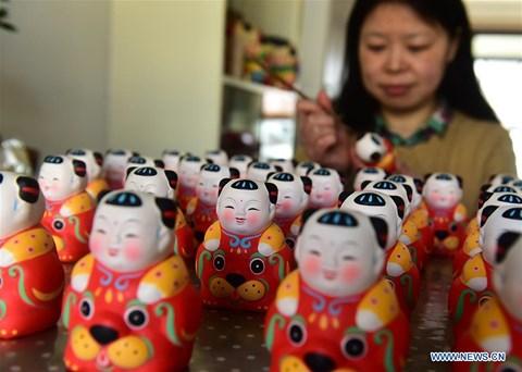Rực rỡ sắc đỏ Tết Nguyên đán tại làng nghề Trung Quốc - hình ảnh 6