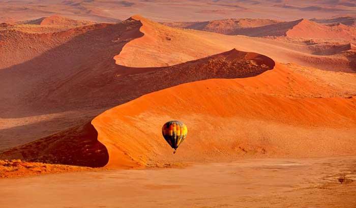 Sa mạc nguy hiểm nhất thế giới, nơi cồn cát đỏ rực mọc trên nền đất trắng như tuyết - 7