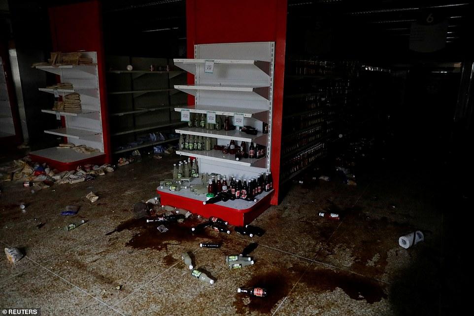 Venezuela chìm trong bóng tối ngày 5: Cướp bóc tràn lan, nhiều bệnh nhân chết - 2