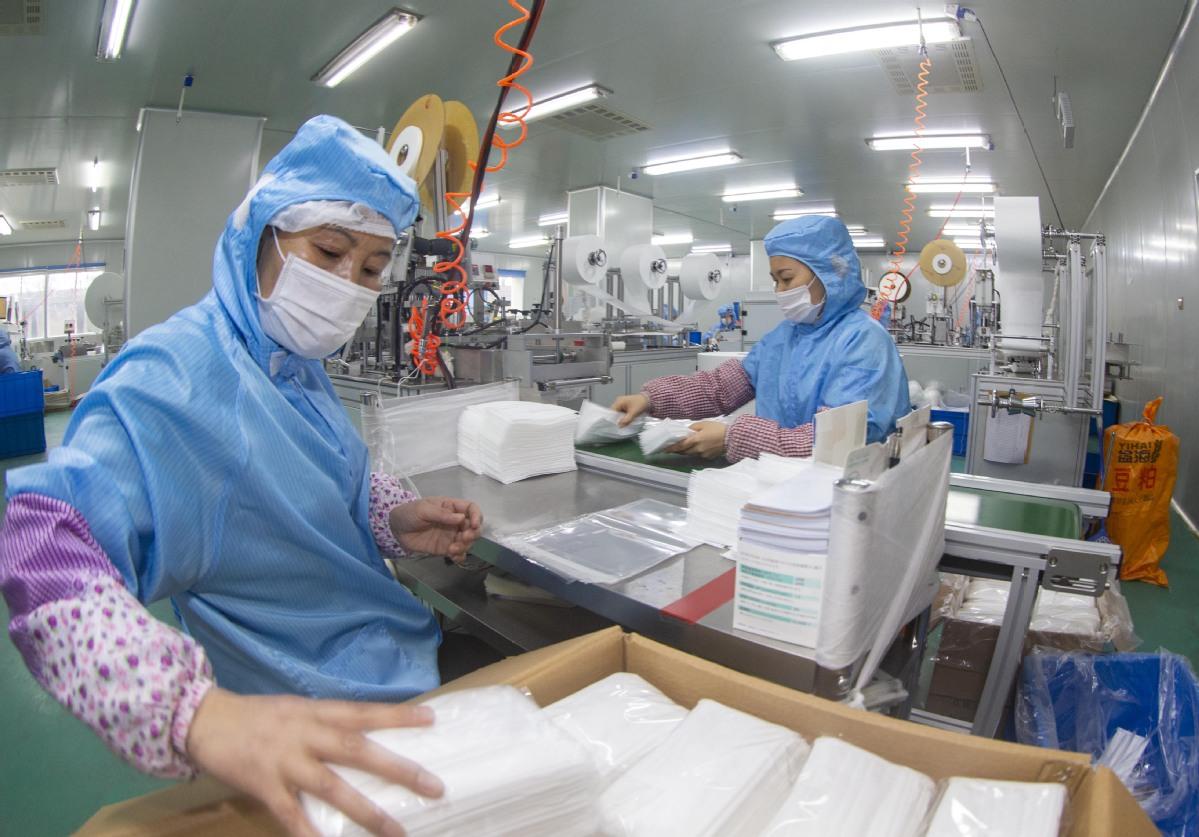 TQ hoàn thành nhà máy sản xuất khẩu trang khổng lồ trong 7 ngày để chống dịch Corona - 1