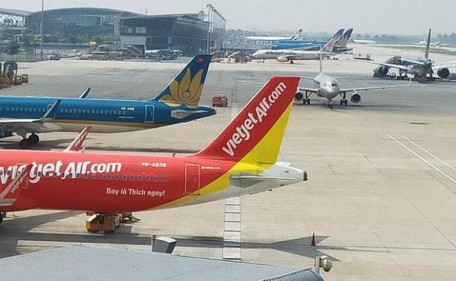 Hàng không Việt Nam thiệt hại hơn 10 ngàn tỉ đồng do dịch Covid-19 - 1