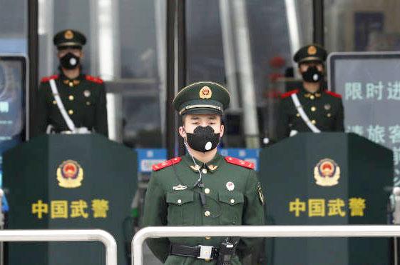 Hàng trăm tù nhân nhiễm Covid-19, quan chức TQ nhận án phạt nặng - 1