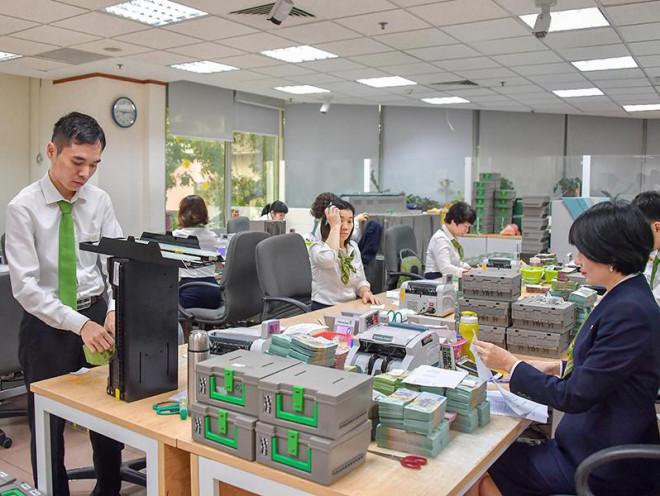 Dịch COVID-19: Ngân hàng cấp bách tiếp sức doanh nghiệp - 1