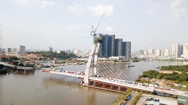 """Ảnh: Cầu biểu tượng mới ở TP.HCM bắc qua sông Sài Gòn """"đứng hình"""" sau 5 năm khởi công - hình ảnh 4"""