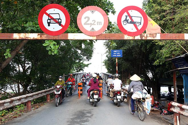 Ngắm cây cầu cấu trúc thép Eiffel hơn 100 tuổi nối đôi bờ sông Sài Gòn đang bị khai tử - 9