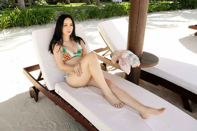 Hoa hậu Đền Hùng mặc bikini thủng lỗ khoe vẻ đẹp tựa tiên sa ở tuổi gần 50 - 9