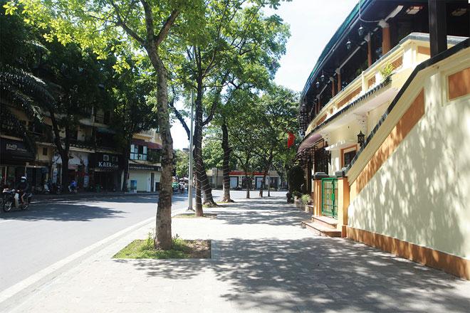 Đường phố Hà Nội vắng người vì trời nóng như đổ lửa - hình ảnh 5