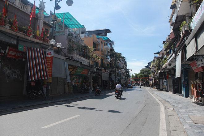 Đường phố Hà Nội vắng người vì trời nóng như đổ lửa - hình ảnh 9