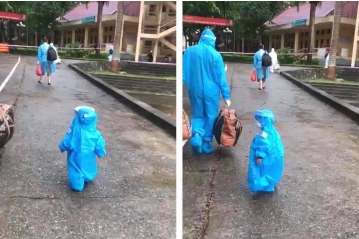 Clip bé trai 3 tuổi bị ung thư trong bộ đồ bảo hộ lon ton bước theo bố gây xúc động - hình ảnh 1