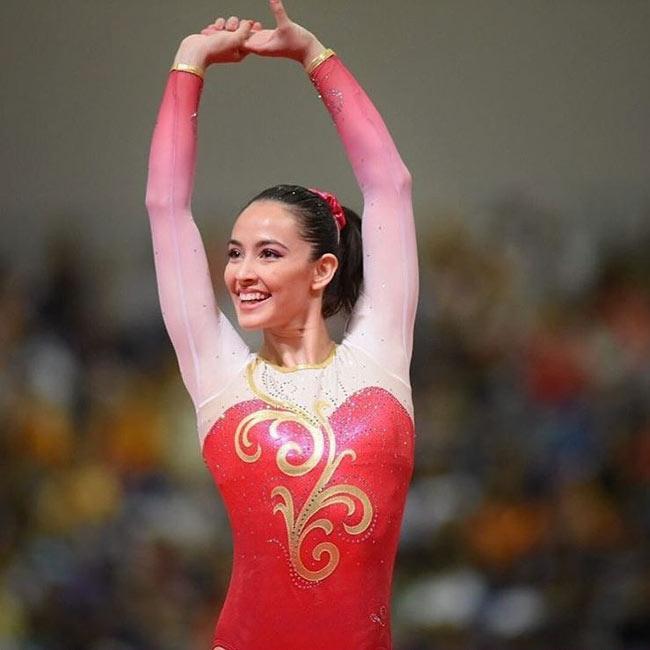 Vẻ đẹp hoàn mỹ của nữ thần thể dục đẹp nhất SEA Games - hình ảnh 18