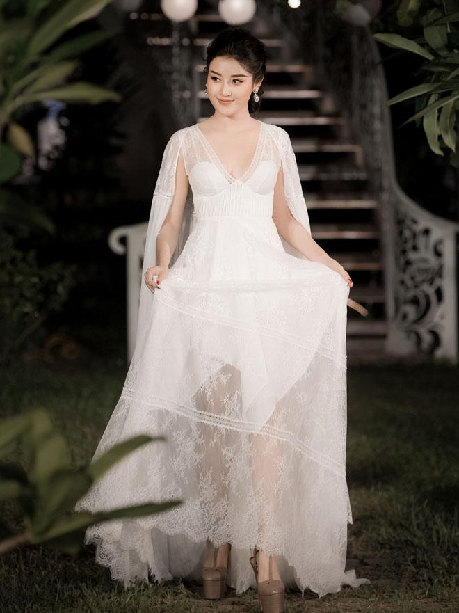 Á hậu Huyền My lấp ló ngực đầy trong làn váy trắng mỏng manh - hình ảnh 3