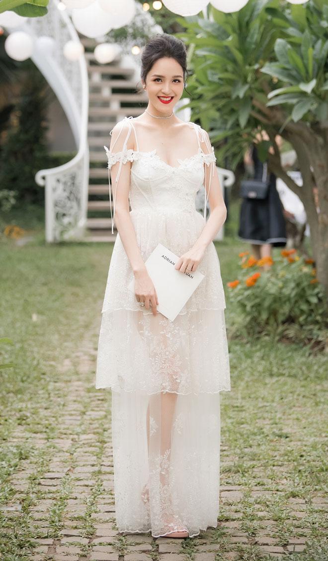 Á hậu Huyền My lấp ló ngực đầy trong làn váy trắng mỏng manh - hình ảnh 6