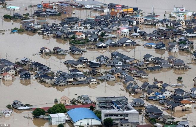 """Mưa lũ """"lớn chưa từng thấy"""" khiến ít nhất 85 người chết ở Nhật - 1"""