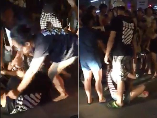 Chồng ôm chặt bồ khi vợ ôm con đi đánh ghen giữa phố Hà Nội - hình ảnh 1