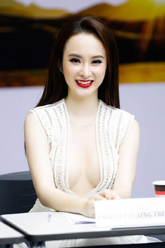 """Những chiếc váy """"để đời"""" khiến Vũ Ngọc Anh, Mai Phương Thúy lúng túng che chắn - hình ảnh 6"""