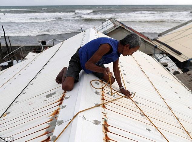 Cảnh tan hoang ở Philippines sau siêu bão Mangkhut sức gió 320 km/giờ - 10