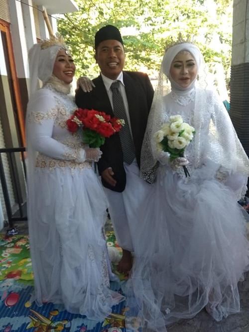 Đám cưới gây sốc khi có một chú rể, hai cô dâu - 4