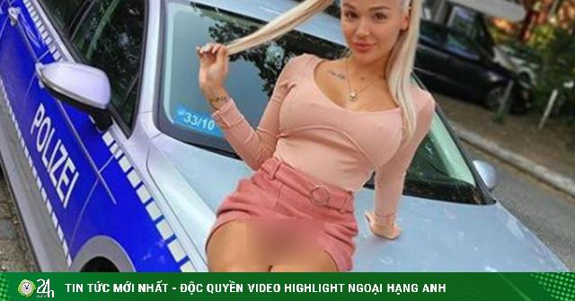 Mặc váy ngắn trèo lên xe cảnh sát chụp ảnh, cô gái nóng bỏng gặp rắc rối