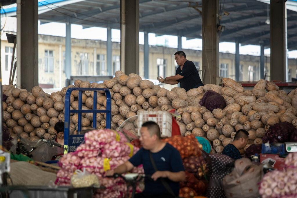 """Toàn cầu """"nín thở"""" khi kinh tế Trung Quốc ngày càng chậm lại - 1"""