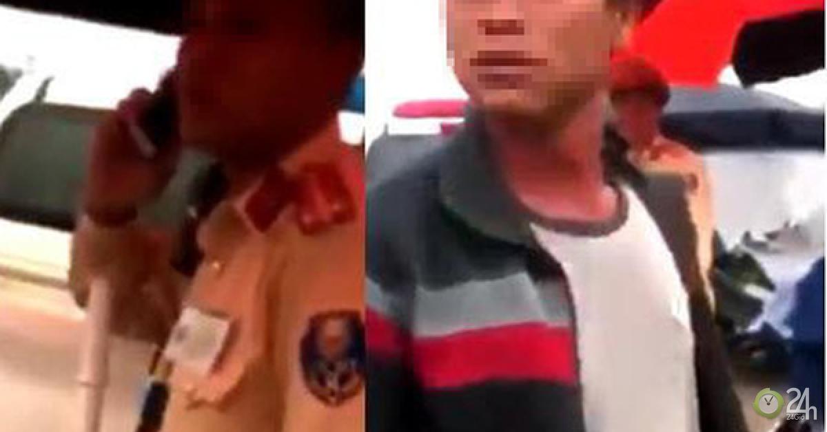 Vụ người dân ghi hình tại chốt CSGT bị hành hung: Xác định người lạ mặt cầm bộ đàm - Tin tức 24h