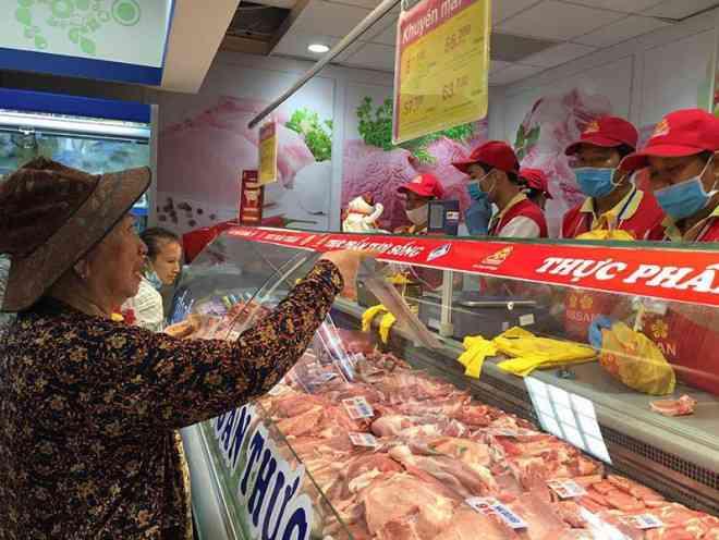 Giảm thuế nhập thịt heo, gà Mỹ: Kẻ cười, người mếu - 1