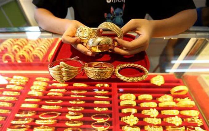 Giá vàng hôm nay 20/10: Vọt tăng chớp nhoáng, dân buôn tranh thủ bán vàng - 1